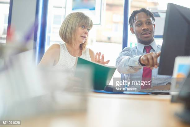 business people discussing work on computer - estate agency stock photos and pictures