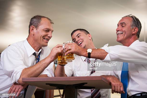 Business people drinking beer after work