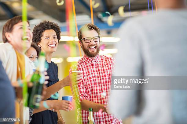 Business people drinking champagne at office party