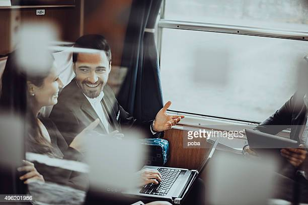Business people during a train journey, working