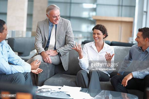Business people enjoying a casual talk at the office lounge