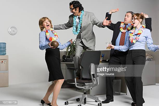business people enjoying office party - work party stock pictures, royalty-free photos & images
