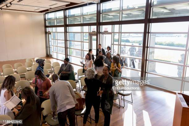 business people enter a conference center - town hall meeting stock pictures, royalty-free photos & images