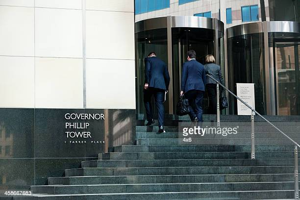 Business people entering a building