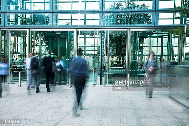 Business People Entering and Exiting an Office Building, Blurred Motion