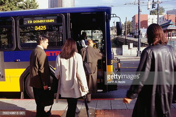 Business people entering bus