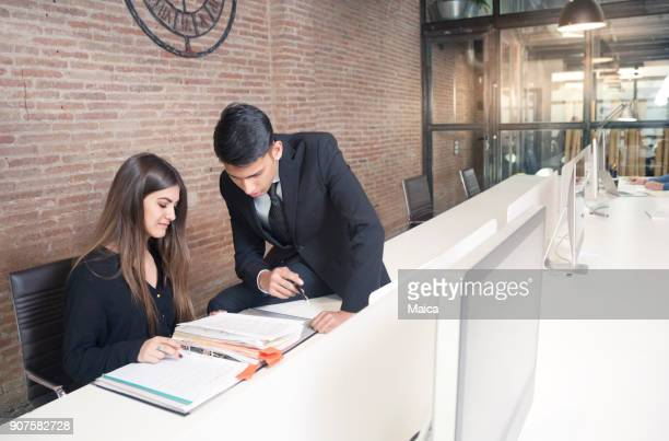 Business people examining documents in office