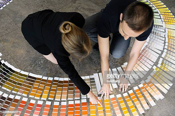 Business people examining paint swatches