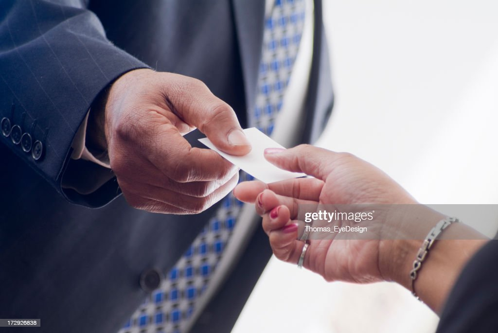 Business People Exchange Business Cards Stock Photo | Getty Images