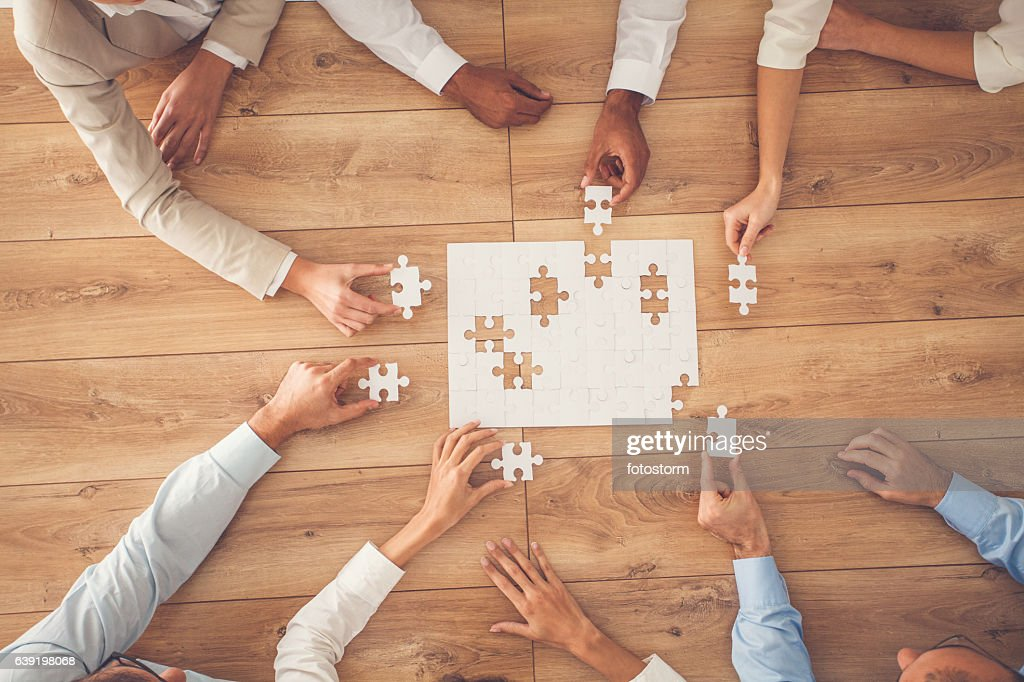 Business people finding solution together at office : Stock Photo