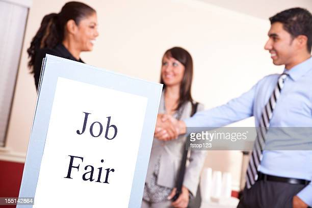 Business people gathering, attend a job fair. Multi-ethnic group.