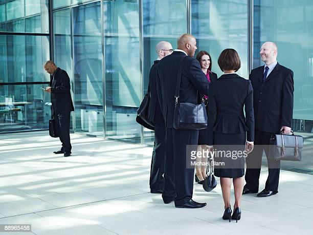 business people gathering to greet each other