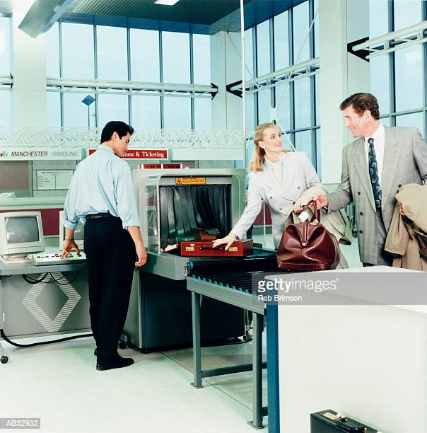 Business people going through airport security check