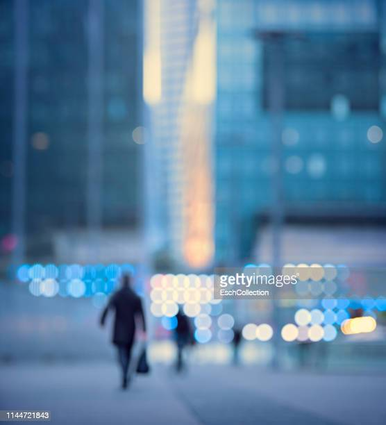 business people going to work at dawn in paris, france - finance and economy stock pictures, royalty-free photos & images