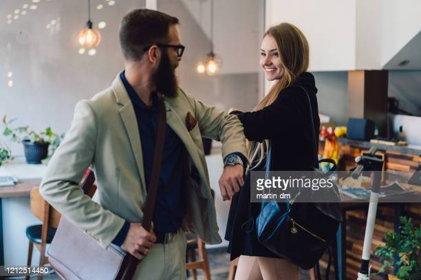 business people greeting during covid-19 pandemic - alternative lifestyle stock pictures, royalty-free photos & images