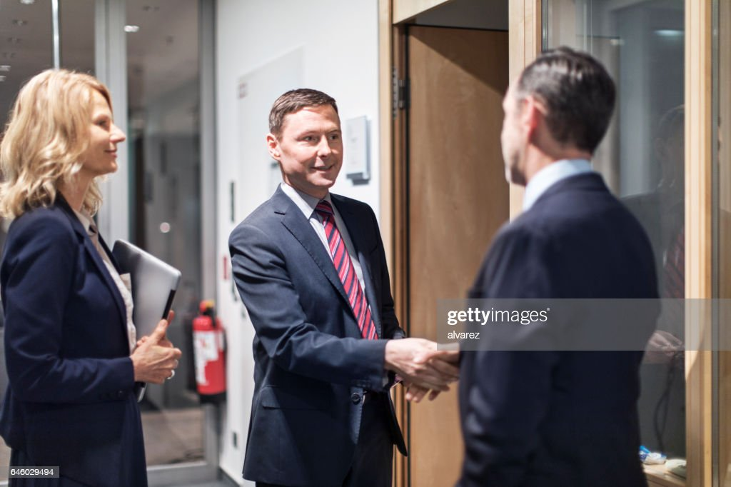 Business people greeting each other in office stock photo getty images business people greeting each other in office stock photo m4hsunfo