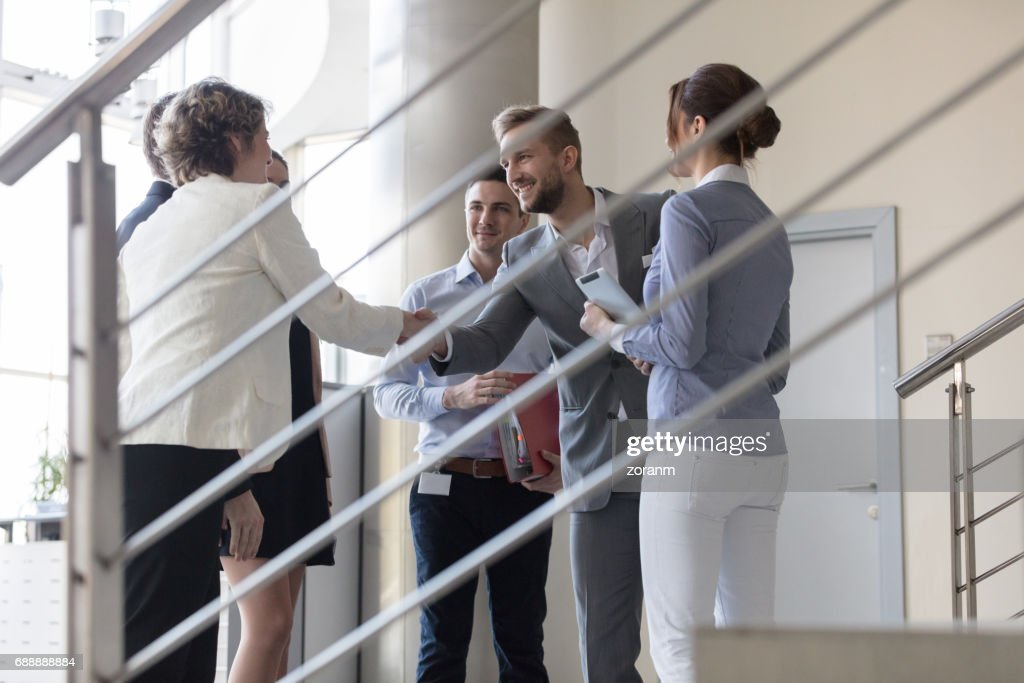 Business people greeting each other stock photo getty images business people greeting each other stock photo m4hsunfo
