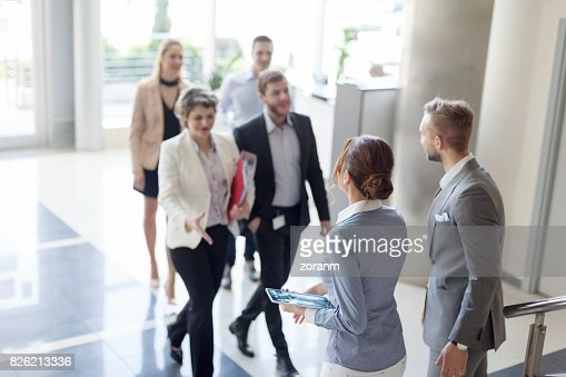Business people greeting each other stock photo getty images similar images view all m4hsunfo