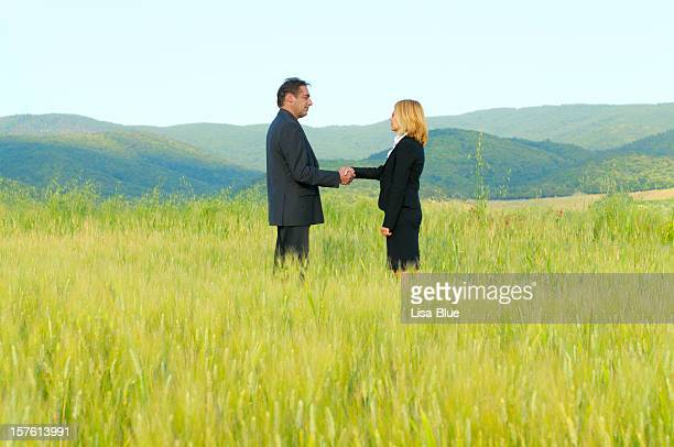 Business People Handshaking in the Countryside