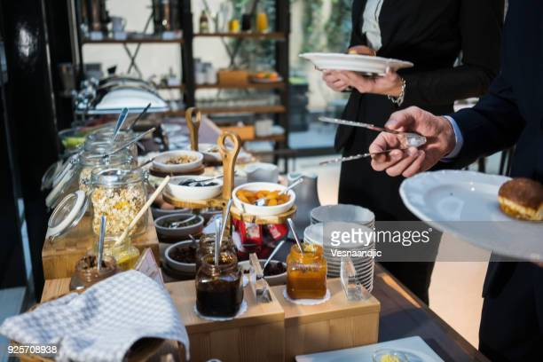 business people have a meal in hotel restaurant - hotel breakfast stock pictures, royalty-free photos & images