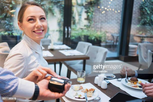 Business people have a meal in hotel restaurant