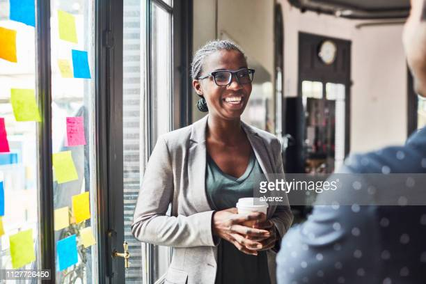 business people having a casual talk during coffee break - casual clothing stock pictures, royalty-free photos & images