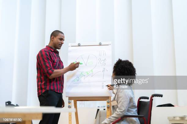 business people having a conference - paraplegic stock photos and pictures