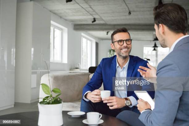 business people having a discussing in break - coffee break stock pictures, royalty-free photos & images