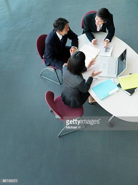 Business people having a discussion in the office.