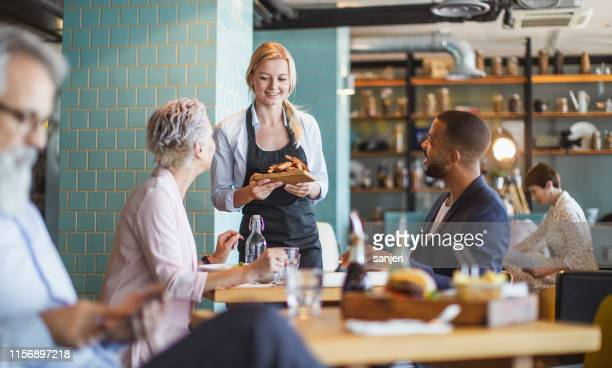business people having a lunch break - restaurant stock pictures, royalty-free photos & images
