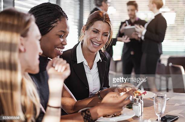 Business People Having a Meal at a Cafe Restaurant