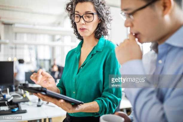 business people having a meeting in office - explaining stock pictures, royalty-free photos & images