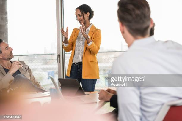business people having a meeting in office - pbs stock pictures, royalty-free photos & images
