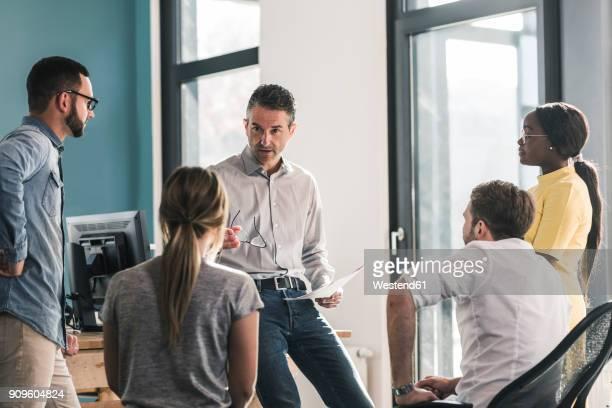 business people having a meeting in office - employee stock-fotos und bilder