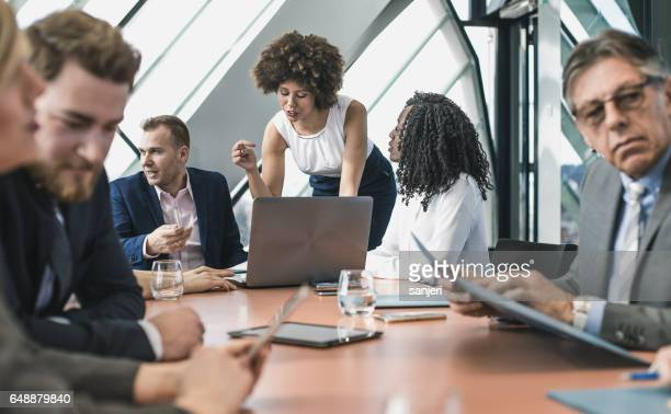 Business People Having a Meeting in the Board Room