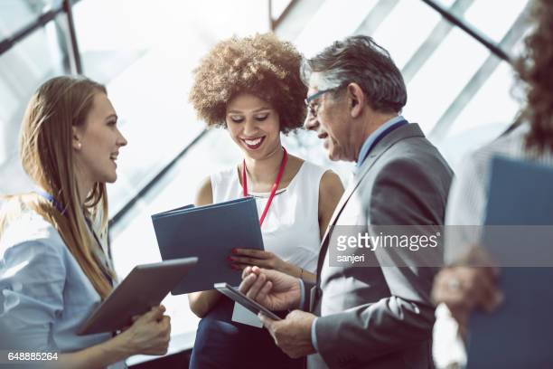business people having a meeting in the board room - attending stock pictures, royalty-free photos & images