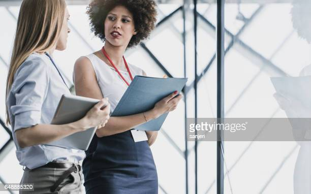 business people having a meeting in the board room - saleswoman stock photos and pictures