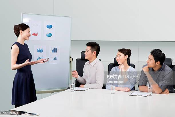 business people having a meeting in the office - ankle length stock pictures, royalty-free photos & images