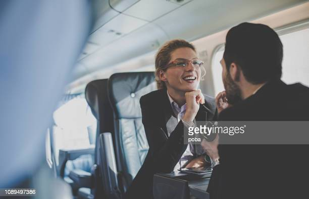 business people having a meeting on a train - railroad car stock pictures, royalty-free photos & images