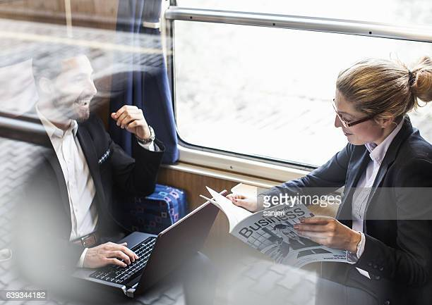Business People Having a Meeting on a Train