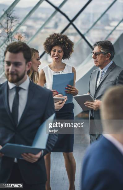 business people having a meeting - financial occupation stock pictures, royalty-free photos & images