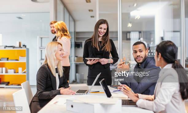 business people having a meeting - employee engagement stock pictures, royalty-free photos & images