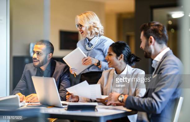 business people having a meeting - business finance and industry stock pictures, royalty-free photos & images