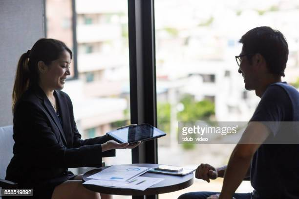 business people having a meeting - tdub_video stock pictures, royalty-free photos & images