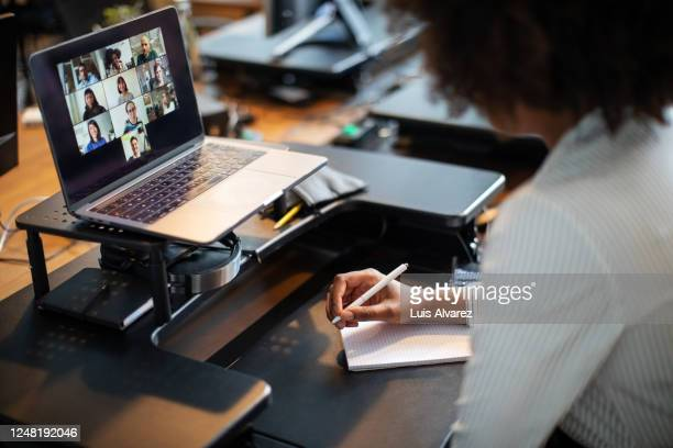 Business people having an online meeting in office