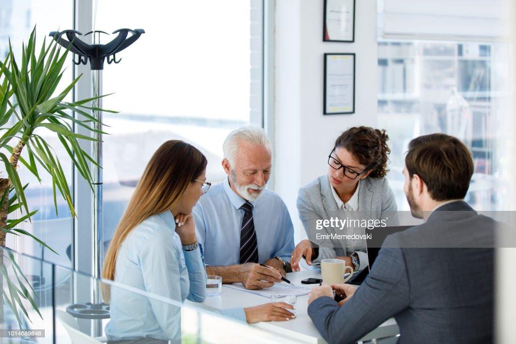 Business people having board meeting in modern office : Stock Photo