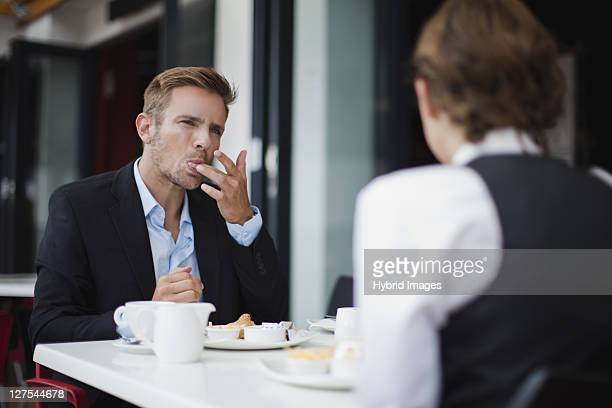 business people having breakfast - licking stock pictures, royalty-free photos & images