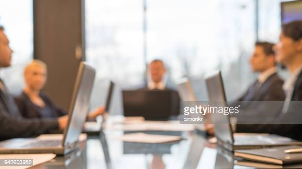 business people having business meeting - soft focus stock pictures, royalty-free photos & images