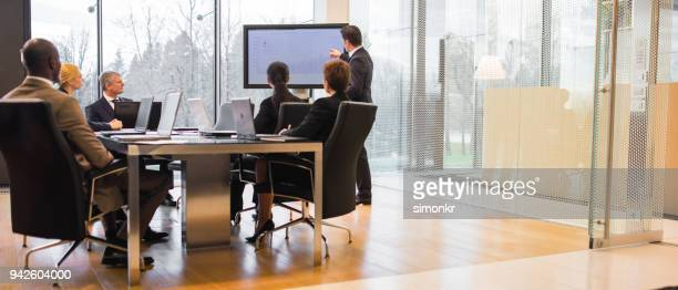 business people having business meeting - presentation stock pictures, royalty-free photos & images