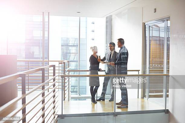 Business people having casual meeting on the aisle